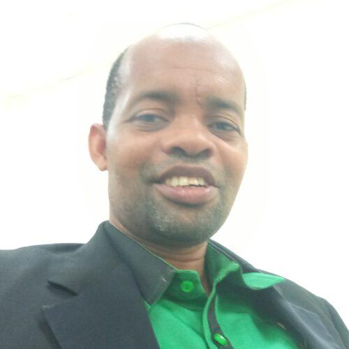 A Tanzanian man wearing a green shrit.