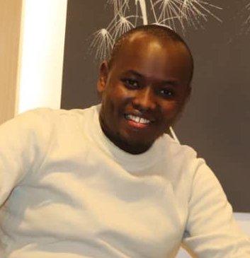 A Tanzanian man with a white turtleneck.