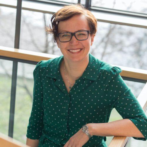 A finish woman wearing a green shirt.