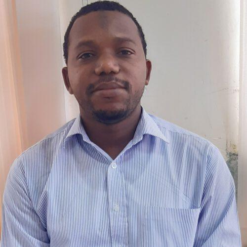 A Tanzanian man wearing a light blue shirt.
