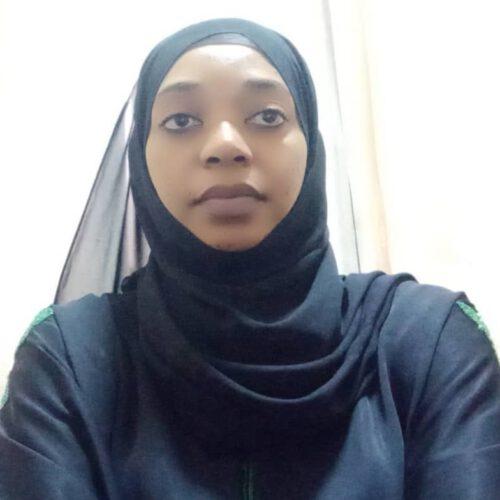 A Tanzanian woman wearing a black jihab.