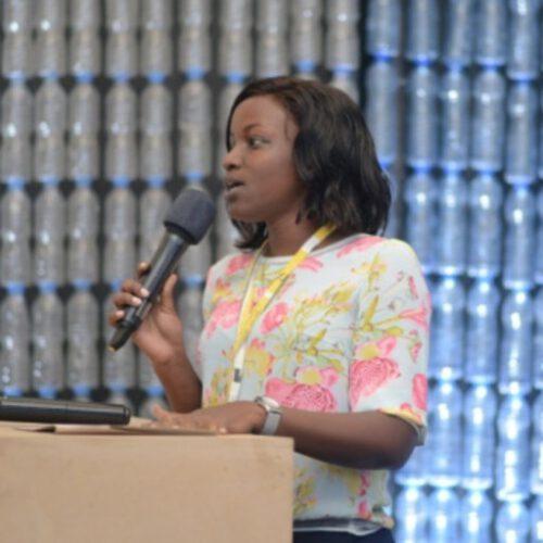 A Tanzanian woman giving a speech.
