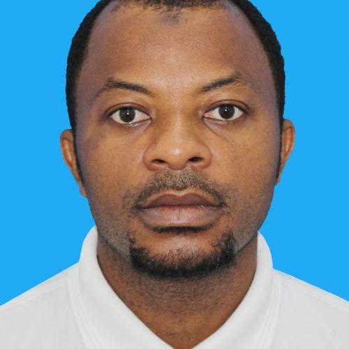 A Tanzanian man in a white shirt