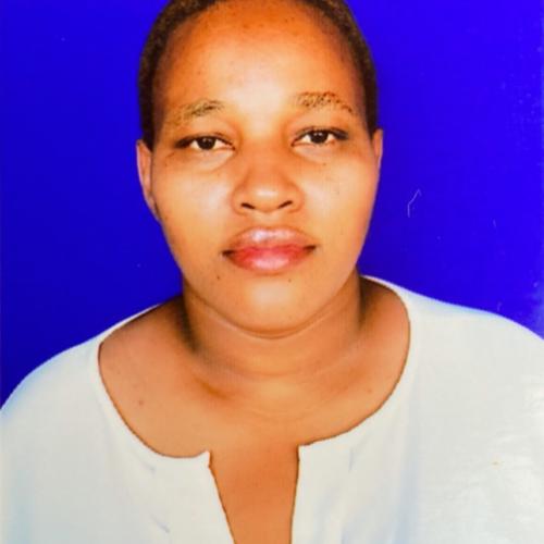 A Tanzanian woman with a white shirt