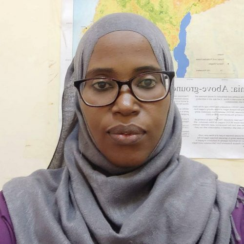 Tanzanian woman with glasses and a map on the background